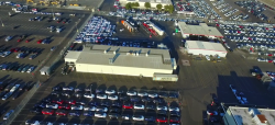 Beautiful new aerial look at Tesla Fremont – lots of cars ready to ship off