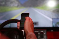 NHTSA proposed new guidelines to curb driver distraction while using mobile devices
