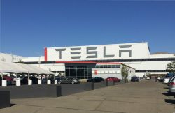 Tesla Reports a $675 Million Q4 Loss While CEO Elon Musk Remains Optimistic