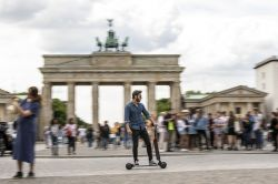 Audi Unveils e-tron Electric Scooter, Skateboard Combo