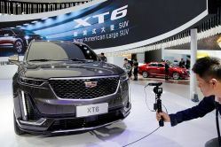 China Tells U.S. Companies, Including General Motors & Qualcomm, They Are Welcome in its Market